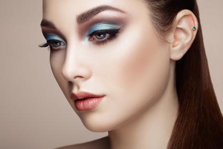 stylish woman: Beautiful woman face. Perfect makeup. Beauty fashion. Eyelashes. Lips. Cosmetic Eyeshadow Stock Photo