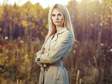 elegant girl: Portrait of young beautiful woman in autumn cloak. Fashion photo. Blonde girl. Perfect make-up Stock Photo