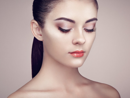 Beautiful woman face. Perfect makeup. Beauty fashion. Eyelashes. Cosmetic Eyeshadow. Highlighting