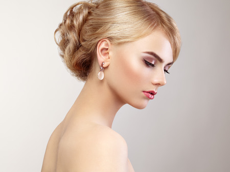 woman hairstyle: Portrait of beautiful sensual woman with elegant hairstyle.  Perfect makeup. Blonde girl. Fashion photo. Jewelry and dress