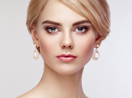 earings: Portrait of beautiful sensual woman with elegant hairstyle.  Perfect makeup. Blonde girl. Fashion photo. Jewelry and dress