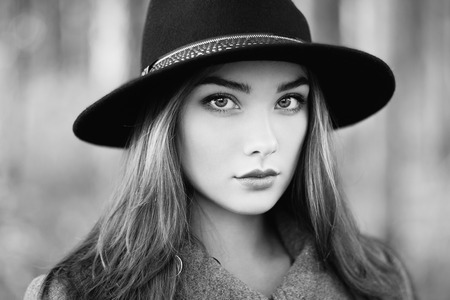 greatcoat: Portrait of young beautiful woman in autumn coat. Girl in hat. Fashion photo
