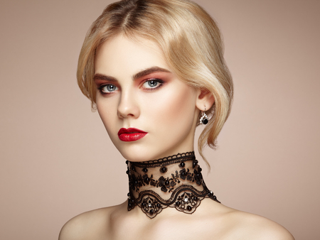 vogue style: Portrait of beautiful sensual woman with elegant hairstyle.  Perfect makeup. Blonde girl. Fashion photo. Jewelry and lace Stock Photo
