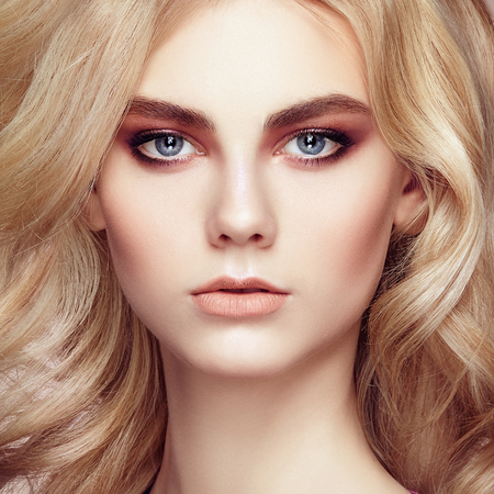 sensual girl: Portrait of beautiful sensual woman with elegant hairstyle.  Perfect makeup. Blonde girl. Fashion photo. Jewelry and dress