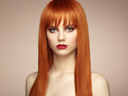 redhead: Portrait of beautiful sensual woman with elegant hairstyle.  Perfect makeup. Redhead girl. Fashion photo