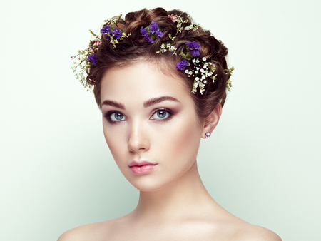 desire: Face of beautiful woman decorated with flowers. Perfect makeup. Beauty fashion. Eyelashes. Cosmetic Eyeshadow