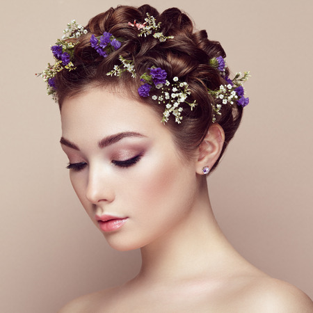 Face of beautiful woman decorated with flowers. Perfect makeup. Beauty fashion. Eyelashes. Cosmetic Eyeshadow Reklamní fotografie - 52216313
