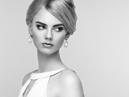 sensual girl: Portrait of beautiful sensual woman with elegant hairstyle.  Perfect makeup. Blonde girl. Fashion photo. Jewelry and dress. Black and white Stock Photo