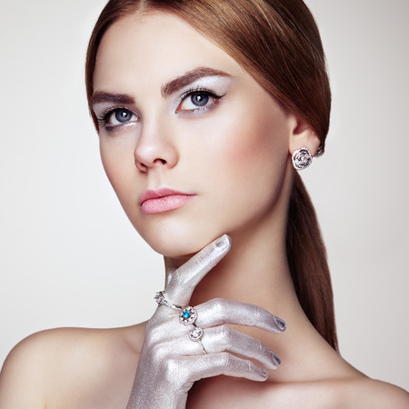diamond ring: Fashion portrait of young beautiful woman with jewelry. Brunette girl. Perfect make-up.  Beauty style woman with diamond accessories Stock Photo