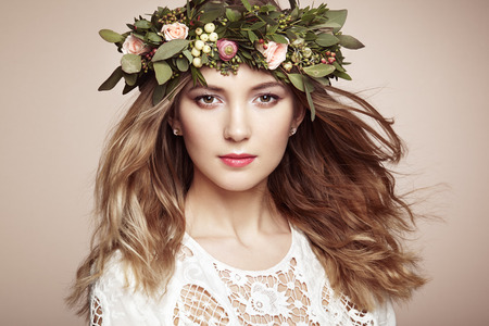 Beautiful blonde woman with flower wreath on her head. Beauty girl with flowers hairstyle. Perfect makeup. Beauty fashion. Spring woman Reklamní fotografie - 54978341