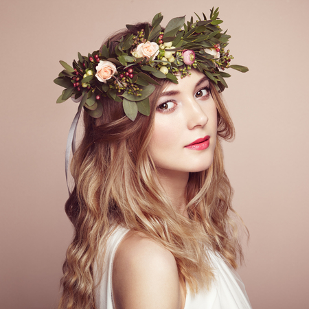 Beautiful blonde woman with flower wreath on her head. Beauty girl with flowers hairstyle. Perfect makeup. Beauty fashion. Spring woman Stok Fotoğraf - 55199096