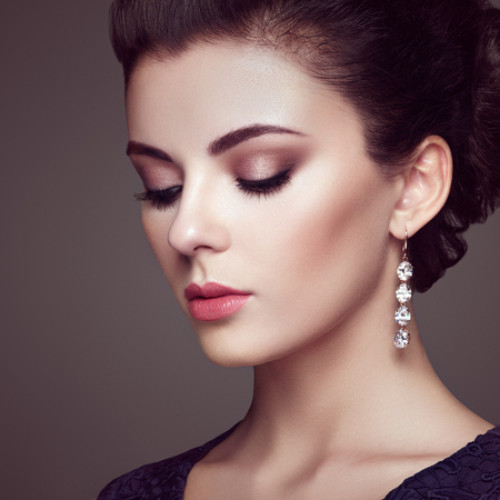 brunette girl: Fashion portrait of young beautiful woman with jewelry. Brunette girl. Perfect make-up.  Beauty style woman with diamond accessories Stock Photo