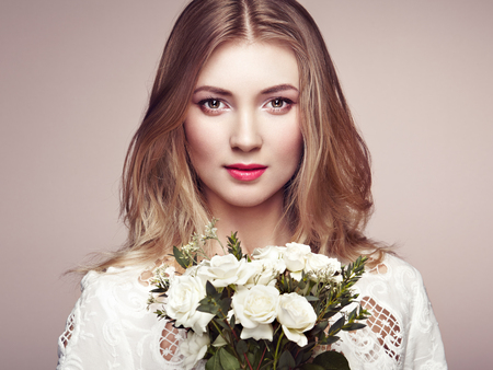 sexy fashion: Portrait of beautiful sensual woman with elegant hairstyle.  Perfect makeup. Blonde girl. Beauty fashion. Flowers