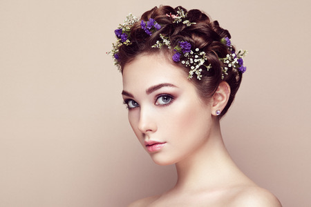 white face: Face of beautiful woman decorated with flowers. Perfect makeup. Beauty fashion. Eyelashes. Cosmetic Eyeshadow