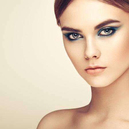 ladylike: Beautiful woman face. Perfect makeup. Beauty fashion. Eyelashes. Lips. Cosmetic Eyeshadow. Perfect skin Stock Photo