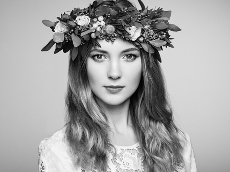 portrait of a women: Beautiful blonde woman with flower wreath on her head. Beauty girl with flowers hairstyle. Perfect makeup. Beauty fashion. Spring woman
