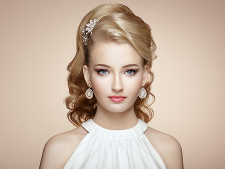 Fashion portrait of young beautiful woman with elegant hairstyle Reklamní fotografie - 62369531