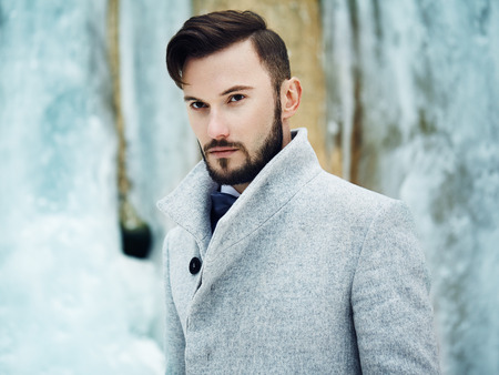 Outdoor portrait of handsome man in gray coat. Fashion photo. Beauty winter style Stock Photo