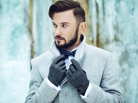 man style: Outdoor portrait of handsome man in gray coat. Fashion photo. Beauty winter style Stock Photo