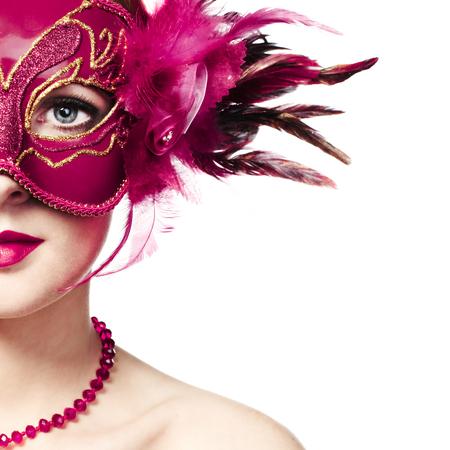 Beautiful young woman in mysterious golden Venetian mask. Fashion photo photo