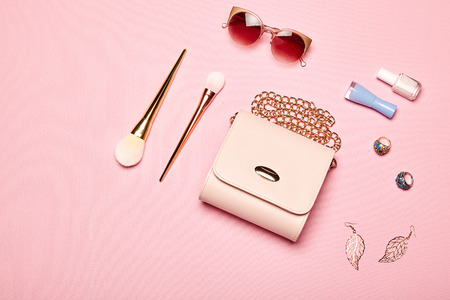 Fashion lady accessories set. Falt Lay. Stylish handbag. Make-Up brushes. Summer sunglasses. Jewelry and nail polish. Women accessories. Trendy fashion design