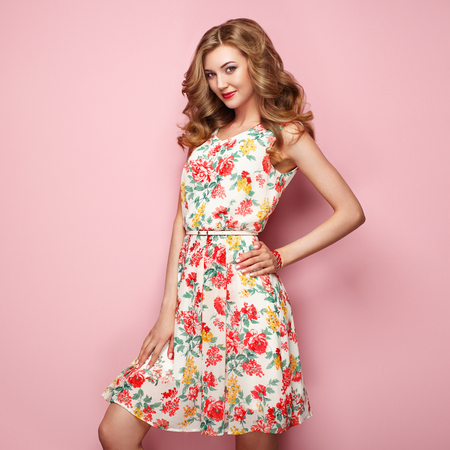 blonde young woman in floral spring summer dress girl posing