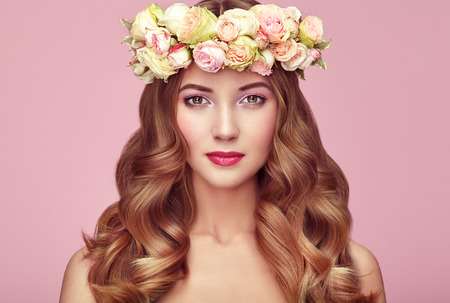 shine: Beautiful blonde woman with flower wreath on her head. Beauty girl with flowers hairstyle. Perfect makeup. Beauty fashion. Spring woman