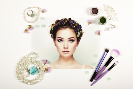 Fashion lady accessories collage. Falt Lay. Beauty photography. Make-Up brushes. Jewelry and lipstick. Fashion portrait of young beautiful woman with elegant hairstyle photo