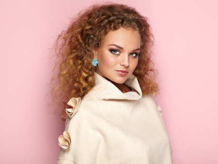 womanly: Beauty woman with long and shiny curly hair. Perfect make-up. Beauty style model with jewelry. Fashion photo
