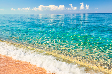 Sea view from tropical beach with sunny sky. Summer paradise beach. Tropical shore. Tropical sea. Exotic summer beach with clouds on horizon. Ocean beach relax, outdoor travel