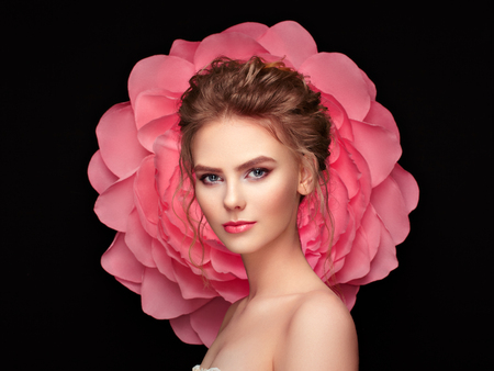 Beautiful woman on the background of a large flower. Beauty summer model girl with pink peony. Young woman with elegant hairstyle and makeup. Fashion photo Stok Fotoğraf - 85546485