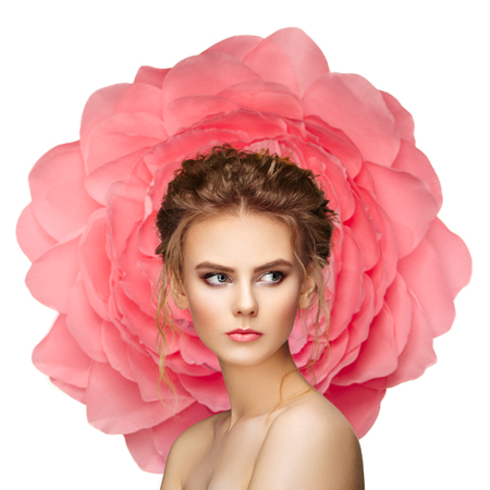 luxurious: Beautiful woman on the background of a large flower. Beauty summer model girl with pink peony. Young woman with elegant hairstyle and makeup. Fashion photo Stock Photo