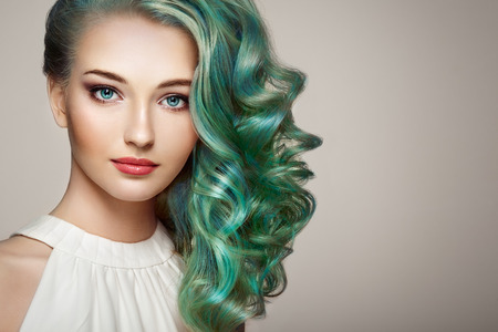 Beauty fashion model girl with colorful dyed hair. Girl with perfect makeup and hairstyle. Model with perfect healthy dyed hair