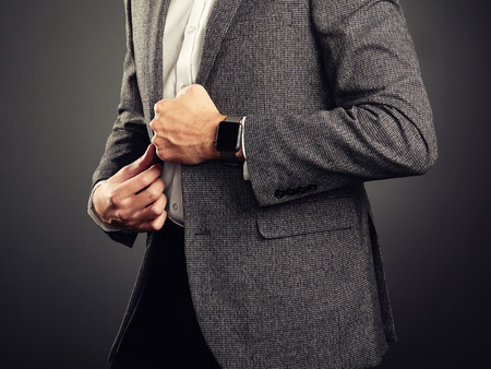 Handsome Young Man in Business Suit. Casual Style and Electronic Gadgets. Smart Watch, Business style