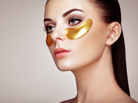 Portrait of Beauty Woman with Eye Patches. Stock Photo