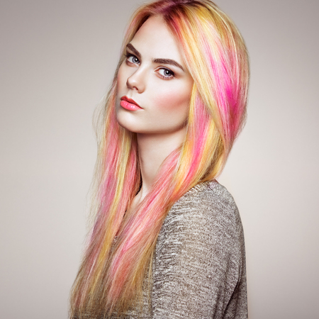 Beauty Fashion Model Girl with Colorful Dyed Hair. Girl with perfect Makeup and Hairstyle. Model with perfect Healthy Dyed Hair. Rainbow Hairstyles Stock Photo - 93194788