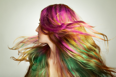 Portrait of young beautiful woman with long flowing hair. Model with perfect Healthy Dyed Hair. Rainbow Hairstyles