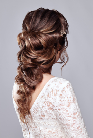 Brunette Woman with Long and shiny Curly Hair. Beautiful Model Lady with Curly Hairstyle. Care and Beauty Hair products. Care and Beauty of Hair Reklamní fotografie
