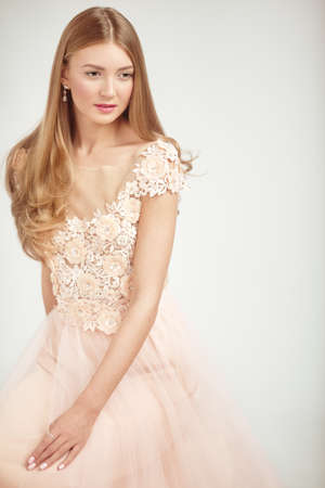 Beautiful Woman in Lace Wedding Dress. Beautiful Lady with Healthy and Beauty Hair Stok Fotoğraf