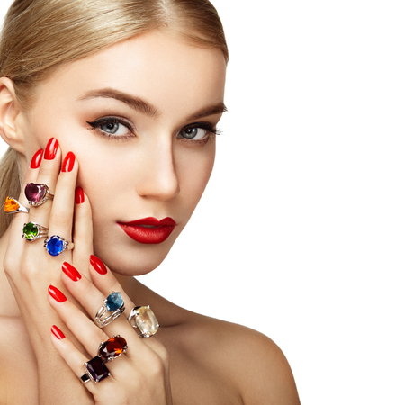 Portrait of beautiful woman with jewelry. Manicure and makeup. Perfect skin. Fashion beauty. Ring. Blonde girl. Close up