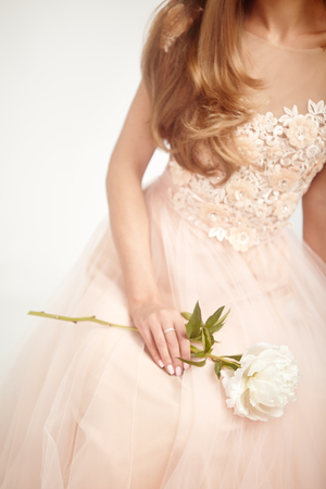 Beautiful Woman in Lace Wedding Dress.  Woman with a peony. Wedding Decoration