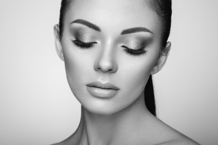 Beautiful Young Woman with Clean Fresh Skin. Perfect Makeup. Beauty Fashion. Eyelashes. Cosmetic Eyeshadow. Highlighting. Cosmetology, Beauty and Spa Stock Photo