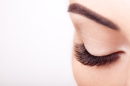 Female Eye with Extreme Long False Eyelashes. Eyelash Extensions. Makeup, Cosmetics, Beauty. Close up, Macro 스톡 콘텐츠