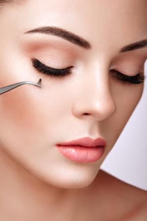 Beautiful Woman with Extreme Long False Eyelashes. Eyelash Extensions. Makeup, Cosmetics. Beauty, Skincare. Woman Glues Eyelashes Stok Fotoğraf
