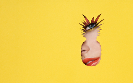 The Face of the Young Beautiful Woman with Bright Pink Shadows and Expressive Eyelashes, Looks in the Pineapple Shaped Pattern out of Yellow Paper. Red Lips. Tropical Patterns. Advertising Banner Stok Fotoğraf
