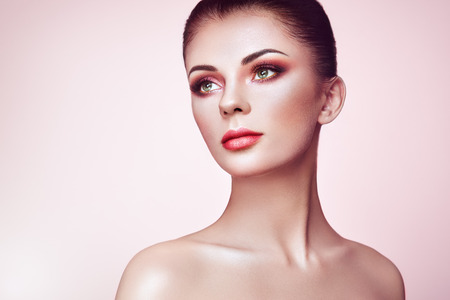 Beautiful Young Woman with Clean Fresh Skin. Perfect Makeup. Beauty Fashion. Eyelashes. Cosmetic Eyeshadow. Highlighting. Cosmetology, Beauty and Spa Reklamní fotografie
