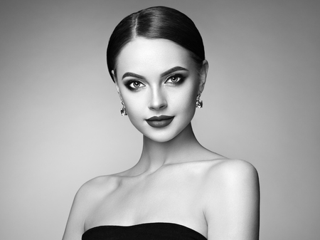 Beautiful Young Woman with Clean Fresh Skin. Perfect Makeup. Beauty Fashion. Eyelashes. Plump Lips. Cosmetic Eyeshadow. Highlighting. Cosmetology, Beauty and Spa. Black and white photo