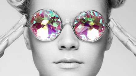 Portrait of Beautiful young Woman with Colored Glasses. Beauty Fashion. Perfect Make-up. Pink Nails Manicured. Colorful Decoration. Holographic sunglasses. Coral color Reklamní fotografie