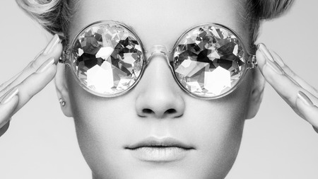 Portrait of beautiful young woman in sunglasses. Beauty Fashion. Black and white photo