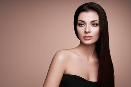 Beautiful Woman with Long Smooth Hair. Girl with Perfect Makeup and Hairstyle. Model Brunette with Perfect Healthy Dark Hair. Fashion Photo Stok Fotoğraf